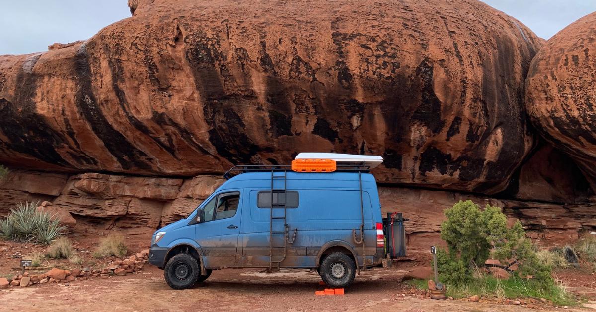 a blue van in the desert